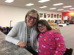 literacy tutor and student with Down syndrome